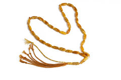 Prayer beads. Muslim amber prayer beads with the tassels on white islolated background royalty free stock photography