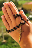 Prayer beads 2. The image describes the hands clasped in prayer holding a rosary Stock Photography