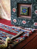 Prayer Beads. In one alcove of the Painted Mosque in Tetovo, Macedonia, these prayer beads are on laying a red and blue rug, with a hand-painted panel in the Royalty Free Stock Photography