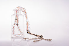 Prayer beads and bottle Royalty Free Stock Photos