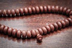 Prayer beads. Close up of wooden Islamic prayer beads Royalty Free Stock Photos