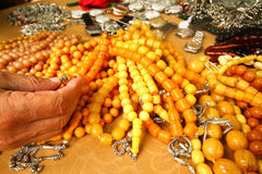 Prayer beads and hand on bazaar. For sale Royalty Free Stock Image