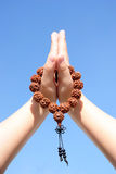 Prayer beads in her hands Royalty Free Stock Photography