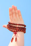 Prayer beads in her hands Stock Photo