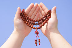 Prayer beads in her hands Stock Photos