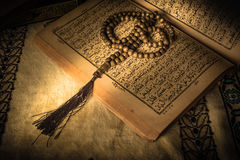 Prayer beads on Koran  holy book of Muslims.  Stock Photos