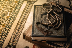 Prayer beads on Koran  holy book of Muslims.  Royalty Free Stock Photo