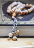 Prayer beads on the Koran. Royalty Free Stock Images