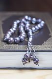 Prayer beads on the Koran. Royalty Free Stock Photos