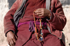 Prayer beads in monk's hand. In India Stock Image