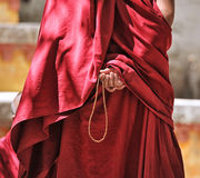 Prayer beads in monk's hand Stock Photos