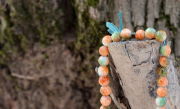 Prayer Beads on a wood Stock Image
