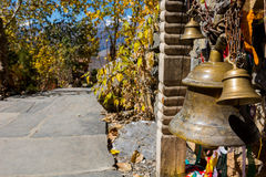 Prayer bells hanging at temple entrance. Stock Image