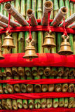 Prayer bells over green bamboo Royalty Free Stock Photos