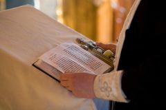 The Prayer Book in the Church. The prayer book and the hands of the priest in the church stock image