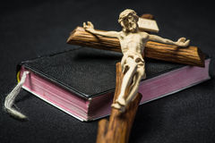 Prayer book and cross. Black Prayer book and Jesus Christ on cross stock photo