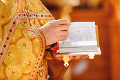 Prayer book in the hands of the priest. Ceremony in the Orthodox Christian Church. Russia. Stock Images