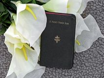 Prayer book and lilies Royalty Free Stock Image