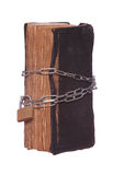 Prayer book protected with padlock and chain Stock Photos