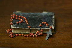 Prayer book and rosary cross. Antique crucifix rosary and book still life Royalty Free Stock Image