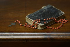 Prayer book and rosary cross. Antique book and rosary still life Stock Photo