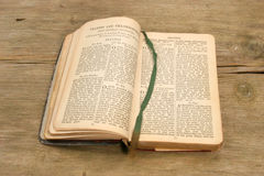 Prayer book on wood. Old prayer book with open pages on old rustic wood Royalty Free Stock Photo