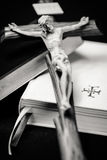 Prayer books and cross. Black and white prayer books and Jesus Christ on cross royalty free stock photos