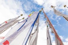 Prayer buddhist mantra white flags sky. Stock Image