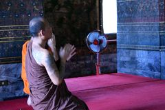 Prayer in Buddhist temple stock photos
