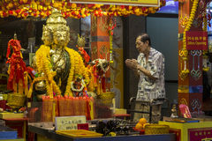 Prayer in Buddhist temple Royalty Free Stock Photography
