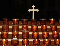 Prayer candles. Prayer candles and cross inside St. Patrick's Cathedral Royalty Free Stock Images