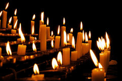 Prayer Candles. Burning prayer candles in a catholic church in Europe Royalty Free Stock Photos