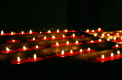 Prayer Candles. Red prayer candles in a church Stock Images