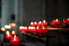 Prayer candles. On a rack in church Royalty Free Stock Photos