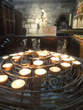Prayer candles. In a Cathedral in Paris Royalty Free Stock Image