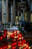 Prayer candles in church Stock Photos