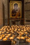 Tabgha, Israel- May 6, 2018 : Prayer candles in the Church of the Multiplication in Tabgha, Israel stock photography