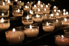 Prayer candles. In the darknes Royalty Free Stock Photos