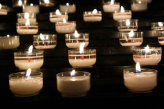 Prayer candles. In the darknes Stock Photo