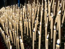 Prayer candles inside the Modena Cathedral Duomo stock photos