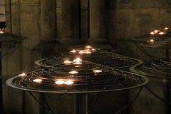 Prayer candles set on large metal stands Royalty Free Stock Photos