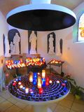 Prayer candles in small chapel. Prayer candles alight in the small chapel on Mont Saint Clair near the city of Sete in southern France stock image