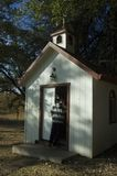 Prayer Chapel. Under trees with a man entering Stock Photos