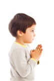Prayer child. Serious boy praying to God, prayer child royalty free stock images