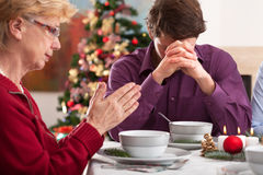 Prayer before christmas dinner Royalty Free Stock Photos