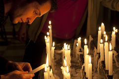 Prayer in church and candles Stock Images