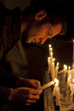Prayer in church and candles Royalty Free Stock Photo