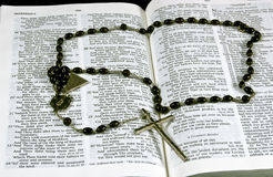 Prayer Closet. Close up of a rosary on an open bible Stock Photos