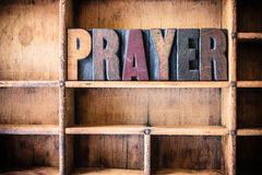Prayer Concept Wooden Letterpress Theme. The word PRAYER written in vintage wooden letterpress type in a wooden type drawer Royalty Free Stock Images