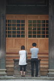 Prayer. A couple paying visit at the Hisoric Budhist Temple at Tsugenji, conveys unconditional prayer in togetherness Stock Photo